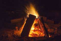 Hot fireplace full of wood and fire burning. Bonfire at the camp Royalty Free Stock Image