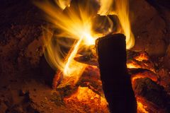 Hot fireplace full of wood and fire burning. Bonfire at the camp Royalty Free Stock Photography