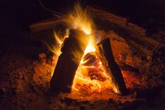 Hot fireplace full of wood and fire burning. Bonfire at the camp Stock Photo