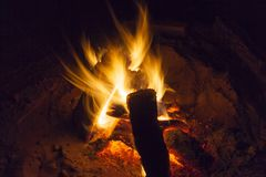 Hot fireplace full of wood and fire burning. Bonfire at the camp Stock Photos