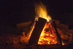 Hot fireplace full of wood and fire burning. Bonfire at the camp Stock Photography