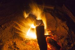 Hot fireplace full of wood and fire burning. Bonfire at the camp Royalty Free Stock Photo