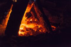 Hot fireplace full of wood and fire burning. Bonfire at the camp Stock Image