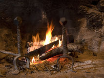 Hot fireplace at home Stock Images