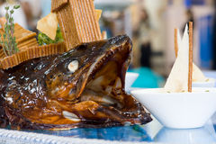 Hot fish dish. Restaurant. Magnificent dish from a fish hunting on the ships Stock Image