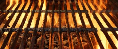 Hot Flaming BBQ Grill With Bright Flames And Glowing Coals Stock Photo