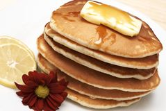 Hot flapjacks with syrup stock photo