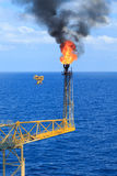 Hot flare boom and fire. On offshore production platform Stock Images