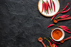 Hot food with red chili pepper dark table background top view mo. Hot food with red chili pepper on dark table background top view mock-up Stock Image