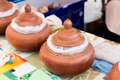 Hot food sale at street market Stock Photos
