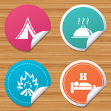 Hot food, sleep, camping tent and fire signs. Round stickers or website banners. Hot food, sleep, camping tent and fire icons. Hotel or bed and breakfast. Road Stock Images