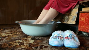 Hot foot bath, relaxation and remedy for colds