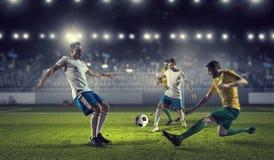 Hot football moments . Mixed media Royalty Free Stock Image