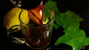 Hot fragrant mulled wine with orange stock video
