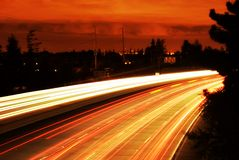 Hot Freeway. Time elapsed freeway with matching red clouds royalty free stock photo