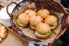 Hot fresh burgers in a wicker basket. royalty free stock image