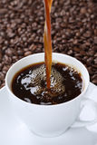 Hot fresh coffee pouring in cup Royalty Free Stock Image