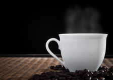 Hot fresh coffee with smoke on cup Stock Image