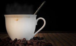Hot fresh coffee with smoke on cup Stock Images
