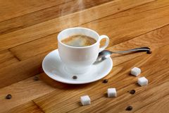 Hot fresh coffee in a white cup with sugar on table Royalty Free Stock Photography