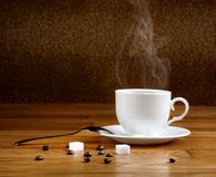 Hot fresh coffee in a white cup Stock Images