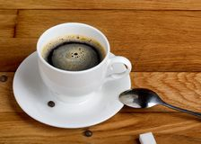 Hot fresh coffee in white cup with sugar on wooden table Stock Photos