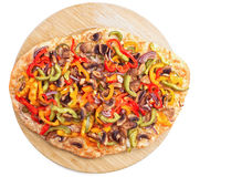 Hot fresh pizza on wooden board Royalty Free Stock Image