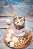 Tea with turkish delight. Hot fresh tea with turkish delight and small dry flowers in studio Stock Photos