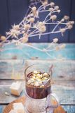 Tea with turkish delight. Hot fresh tea with turkish delight and small dry flowers in studio Stock Photography