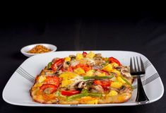 Hot fresh vegetarian flatbread pizza. Pizza made with organic fresh ingredients Royalty Free Stock Photography