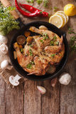 Hot Fried Chicken tobacco with herbs and garlic in a pan. Vertic Royalty Free Stock Photo