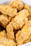 Hot fried chicken wings basket Stock Photos