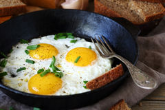 Hot fried eggs in a pan royalty free stock photo