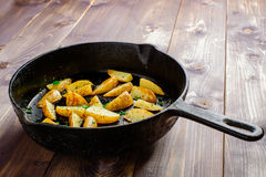 Hot fried potatoes. In a pan Royalty Free Stock Photos