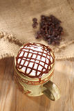 Hot frothy  coffee cappuccino chocolate topping. In rustic style, shallow dof Royalty Free Stock Image