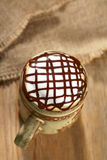 Hot frothy  coffee cappuccino chocolate topping. In rustic style, shallow dof Stock Photography