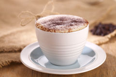 Hot frothy drink cappuccino coffee, rustic style. Shallow dof Royalty Free Stock Photos