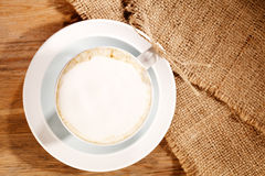 Hot frothy drink cappuccino coffee, rustic style. Shallow dof Stock Photo