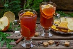 Hot fruit tea with orange, apple, lemon, raisin and spices Stock Photo