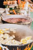 Hot fruit tea in the pots on the coals royalty free stock images
