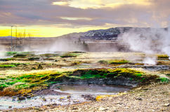 Hot geysers valley in Iceland. A puddle of a hot geyser at sunset in Golden circle tour Royalty Free Stock Photos