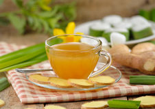 Hot ginger tea. On wooden background stock photography