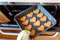 Bake the cookies. Hot and tasty gingerbread cookies made at home with love and care. Great shot Stock Photo