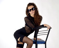 Hot girl. There is hot girl holds blue and black chair royalty free stock image