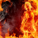 Hot girl. Dancing fire girl on black background Royalty Free Stock Image