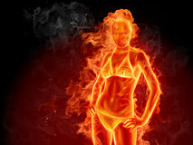 Hot girl. Fiery girl against black background Stock Photo
