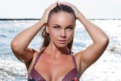 Hot girl on the beach stock photography