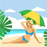 Hot girl on a beach under umbrella. Royalty Free Stock Images