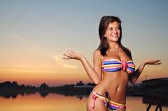 Hot girl in bikini on sunset. Hot young beautiful girl posing in bikini on beach in sunset Royalty Free Stock Photo