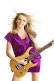 Hot girl playing an electric guitar. Isolated on white background royalty free stock image